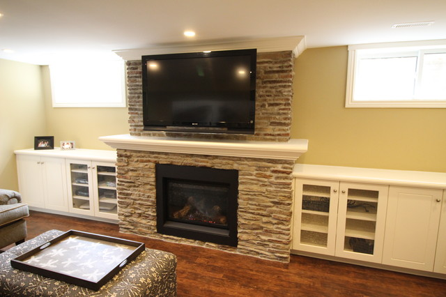 Basement recreation room with new stone fireplace and built-ins - Rustic - Basement - Toronto ...