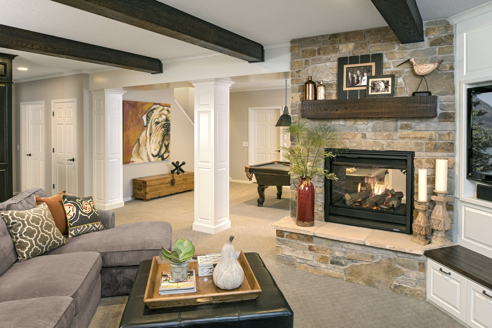 Large transitional look-out carpeted and gray floor basement photo in Minneapolis with a standard fireplace and a stone fireplace