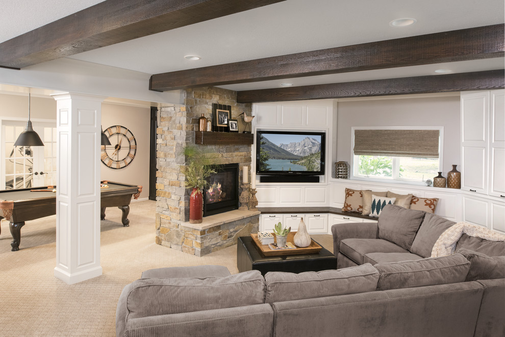 Inspiration for a large transitional look-out carpeted and gray floor basement remodel in Minneapolis with a standard fireplace, a stone fireplace and white walls
