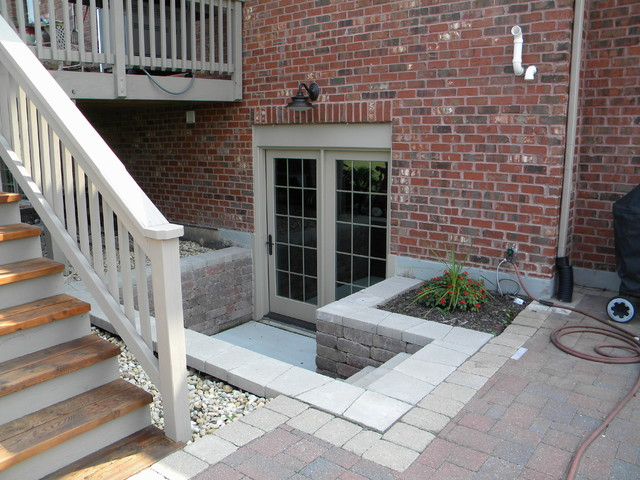 Basement remodel traditional basement chicago by for Walkout basement patio ideas