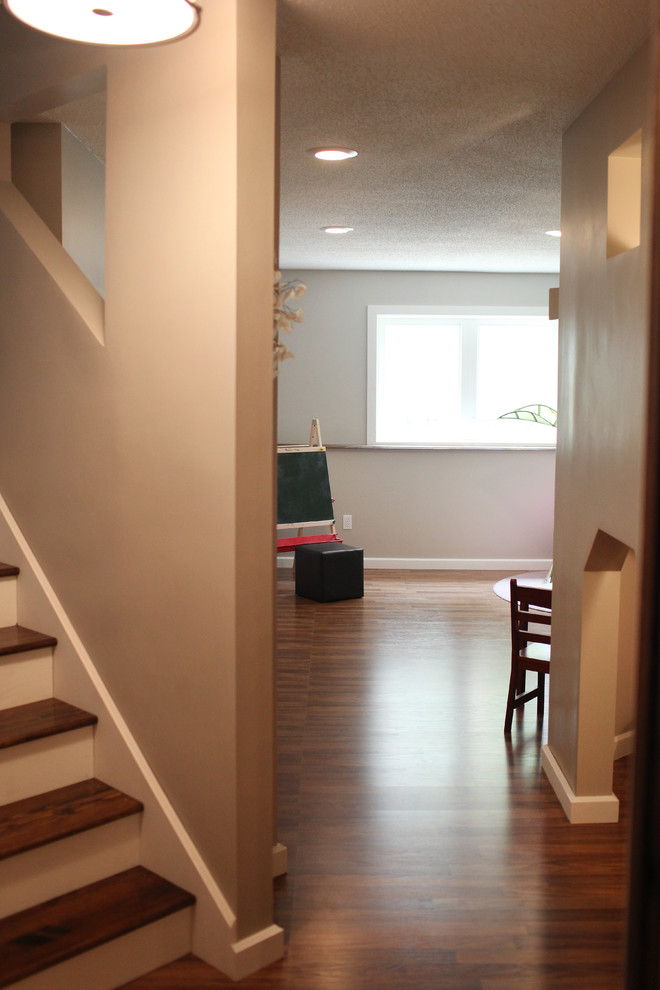 Basement - large traditional look-out vinyl floor basement idea in Minneapolis with gray walls and no fireplace