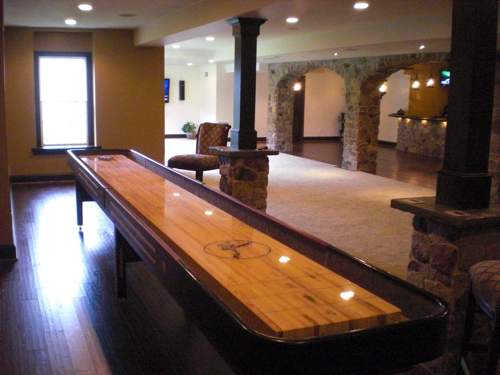 Basement - large traditional look-out dark wood floor and multicolored floor basement idea in Philadelphia with beige walls