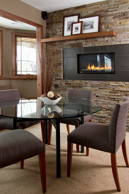 Inspiration for a contemporary look-out carpeted and beige floor basement remodel in Minneapolis with beige walls and a ribbon fireplace
