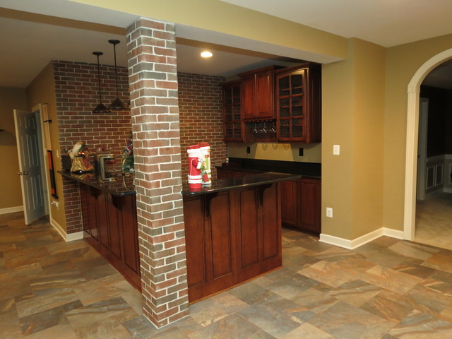 basement remodel with new bar and ceramic tile floor traditional