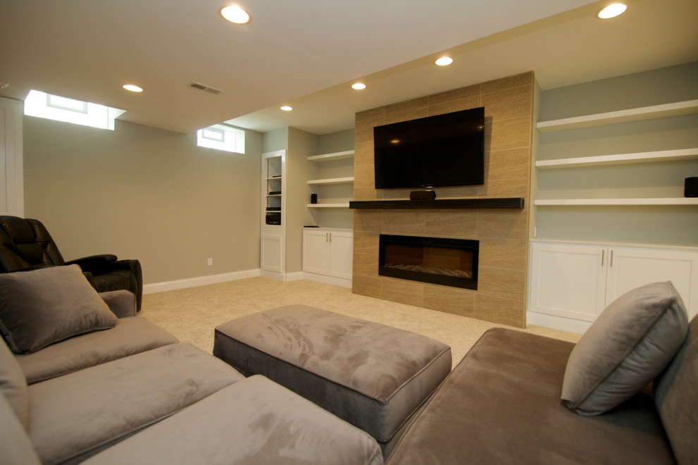 Basement - huge modern walk-out basement idea in Columbus with green walls and a ribbon fireplace