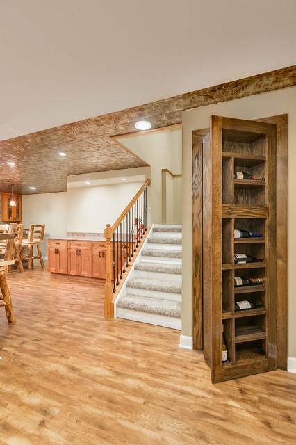 Basement Stairs And Hidden Bookcase Door Rustic