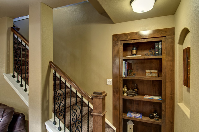 Basement stairs and hidden bookcase transitional for Finishing a basement step by step guide