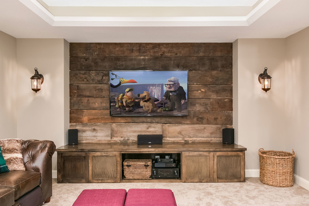 Mid-sized mountain style walk-out medium tone wood floor and brown floor basement photo in Minneapolis with beige walls, a two-sided fireplace and a stone fireplace
