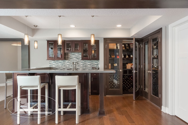 basement wet bar wine cabinets traditional basement minneapolis by finished basement. Black Bedroom Furniture Sets. Home Design Ideas