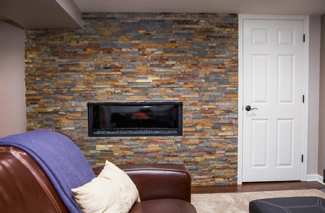 Basement with stone fireplace and half bathroom for Fireplace half stone