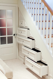 Built-in draws below stairs.