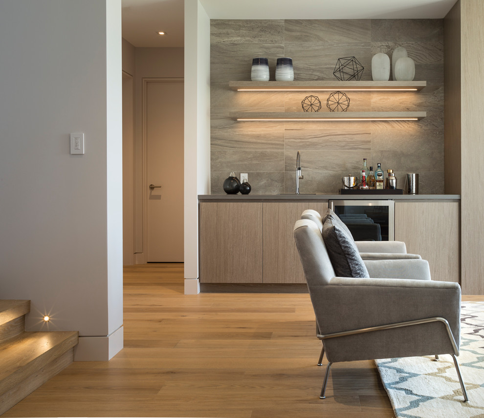 Basement - large contemporary walk-out medium tone wood floor basement idea in Vancouver with white walls