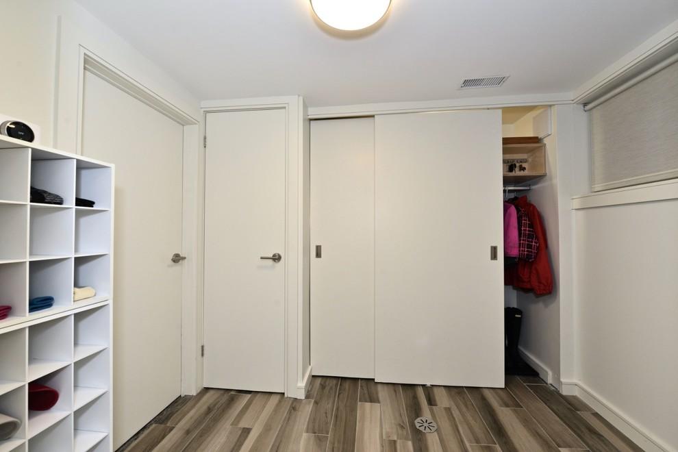 Basement - mid-sized scandinavian underground porcelain tile and gray floor basement idea in Toronto with gray walls