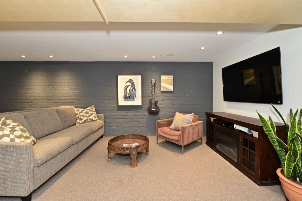 Basement - mid-sized scandinavian underground porcelain floor and gray floor basement idea in Toronto with gray walls