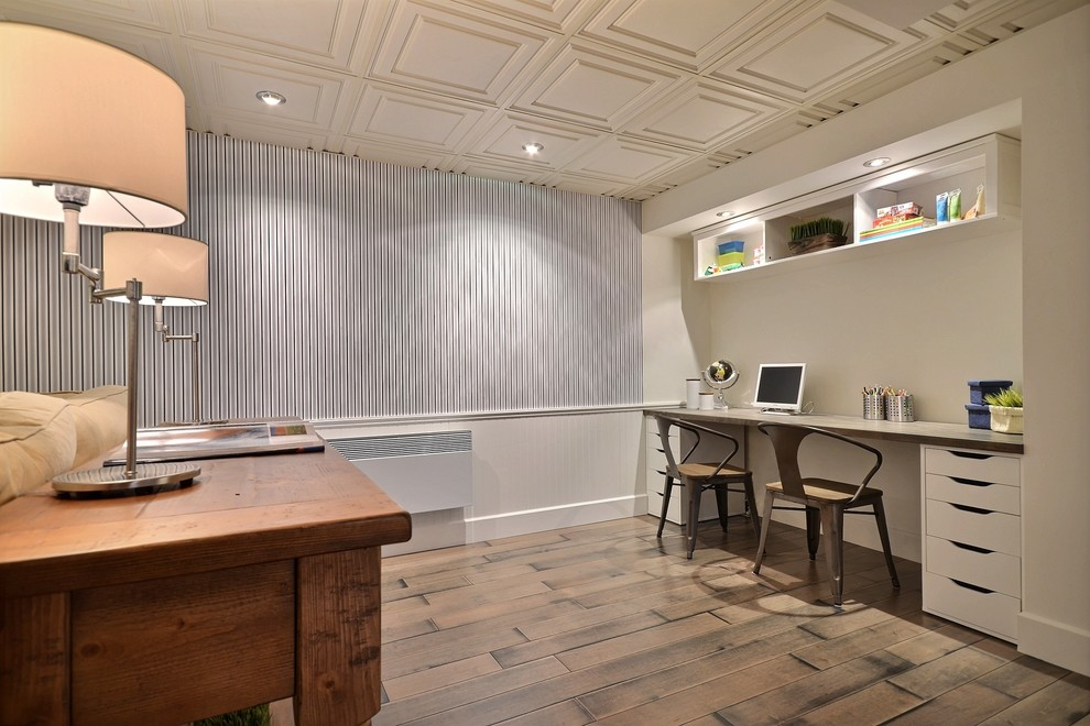 Transitional underground dark wood floor and beige floor basement photo in Montreal with blue walls and no fireplace