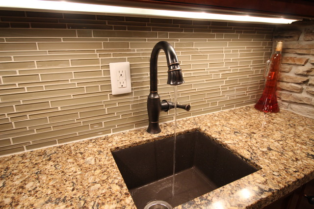 Brizo Oil Rubbed Bronze Faucet And Blanco Silgranit Sink In Cafe  Rustic Basement