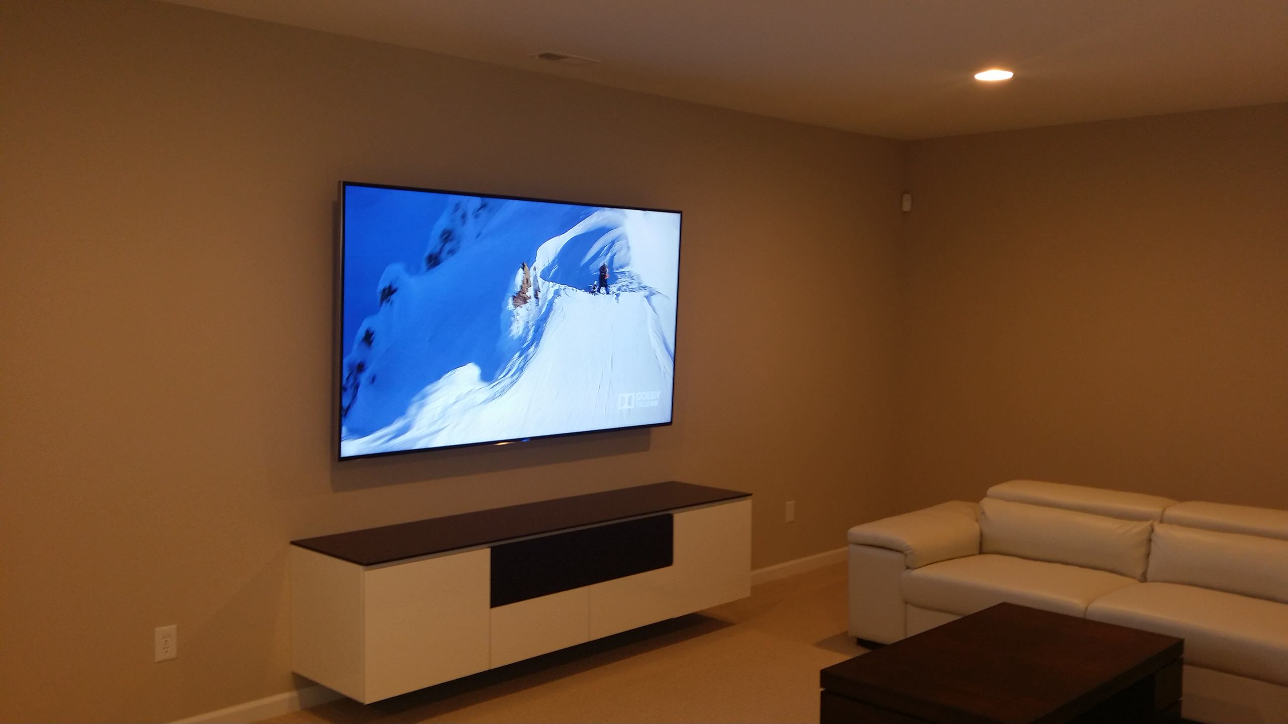 "Carmel, IN - 85"" Mounted TV Panel, Floating Furniture, Hidden Surround Sound"