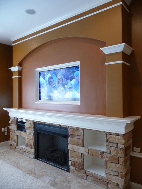 Cincinnati Fireplace/Media Center Design by Lou Vaughn traditional-basement