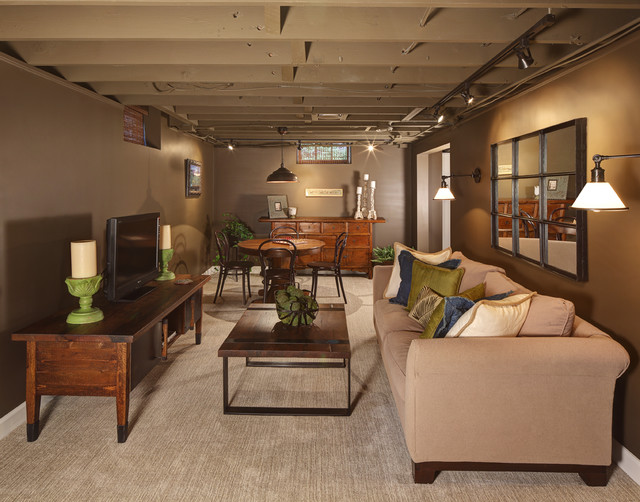 Inspiration for a timeless carpeted basement remodel in Milwaukee with brown walls