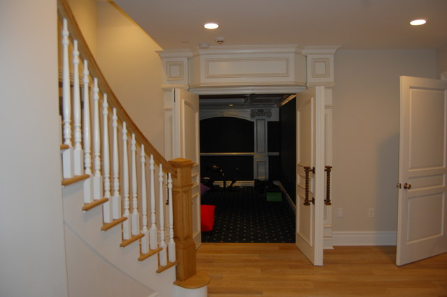 Basement - huge traditional look-out light wood floor and beige floor basement idea in New York with beige walls and a two-sided fireplace