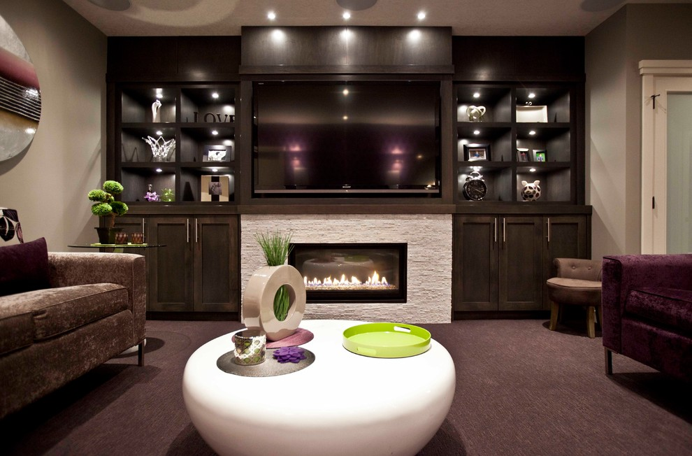 Basement - transitional underground carpeted basement idea in Calgary with gray walls, a ribbon fireplace and a stone fireplace