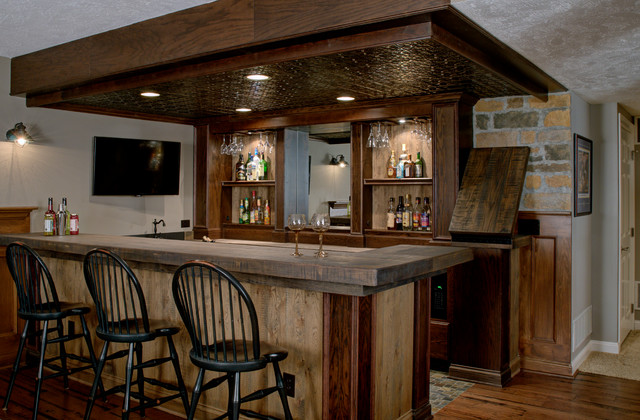 ideas for outside metal decor over garage - Custom Basement Bar Rustic Basement Columbus by