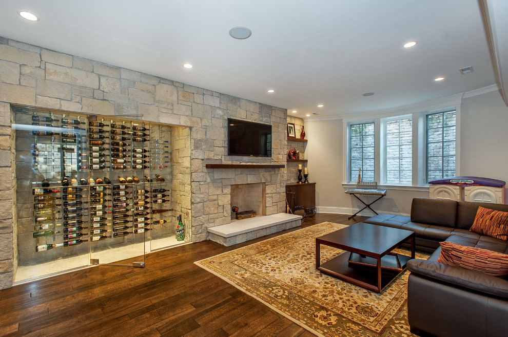 Basement - transitional look-out dark wood floor basement idea in Chicago with a stone fireplace, a standard fireplace and white walls