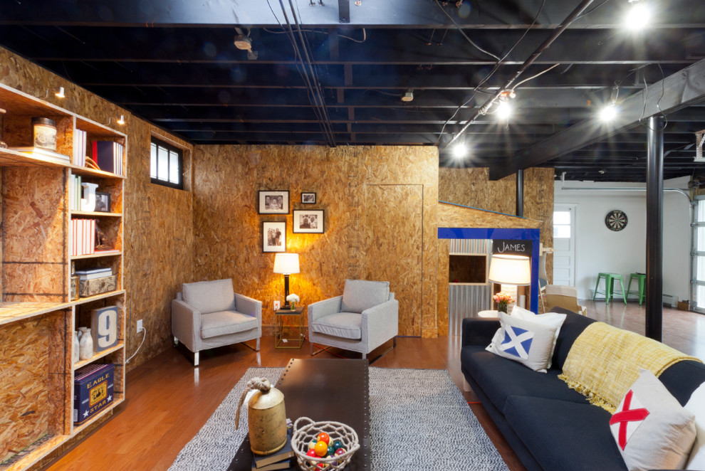 Basement - industrial walk-out medium tone wood floor and orange floor basement idea in New York with no fireplace