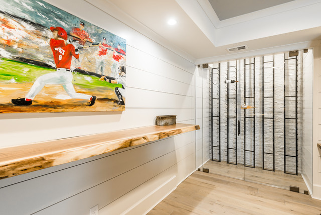 Basement - huge country basement idea in Atlanta with white walls