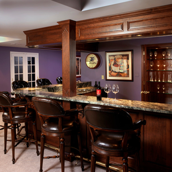 Example of a mid-sized classic underground carpeted basement design in Philadelphia with purple walls