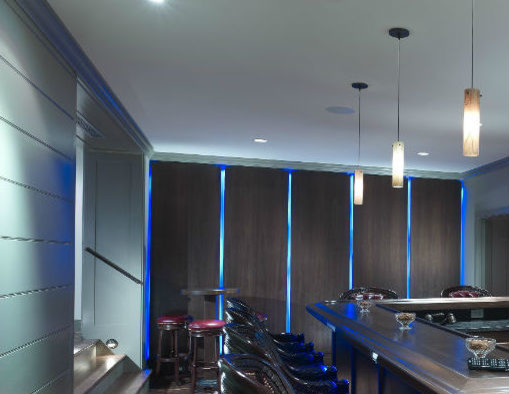 Floating panel wall with LED lighting traditional-basement