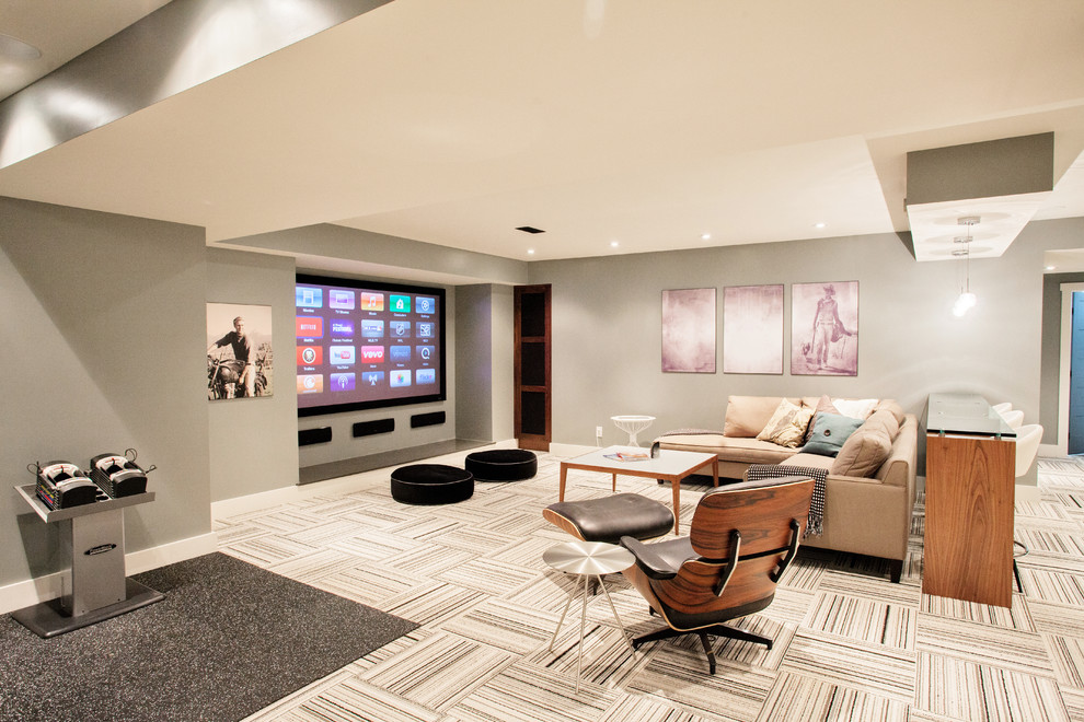 Example of a trendy underground carpeted and multicolored floor basement design in Toronto with gray walls, no fireplace and a home theater