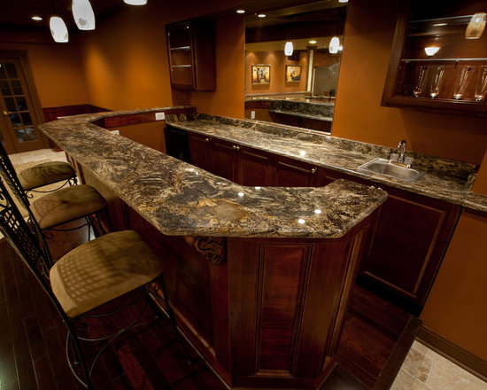 golden thunder granite basement bar in luxury man cave