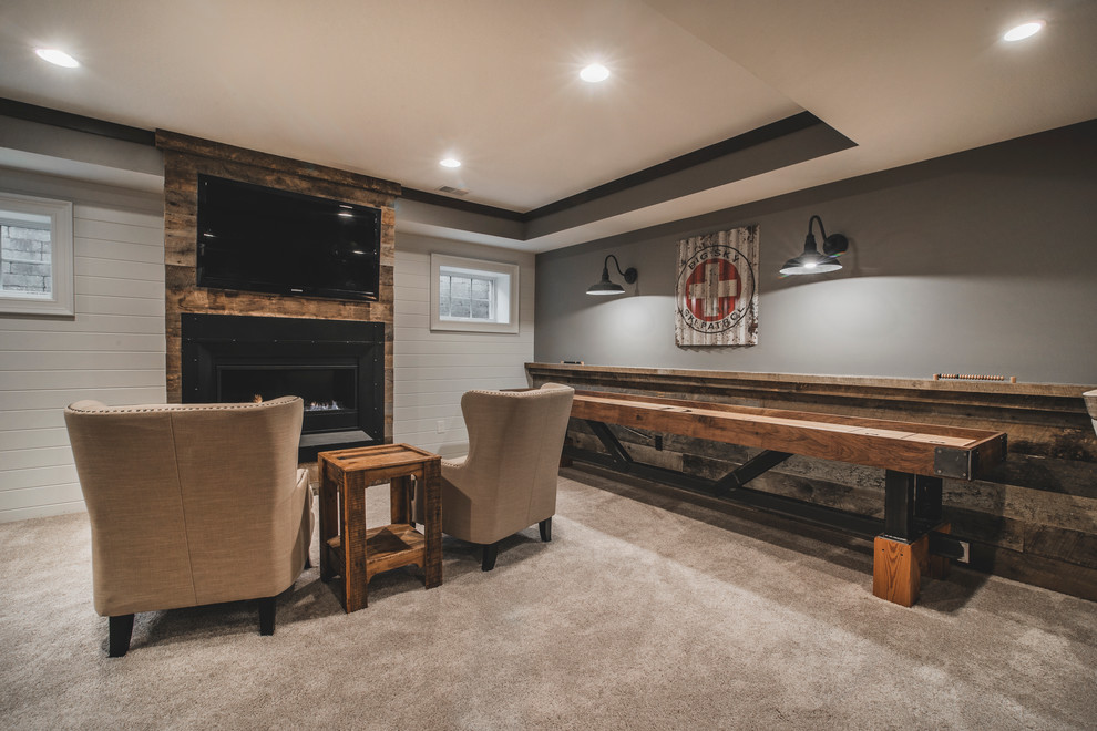Inspiration for a large rustic look-out carpeted basement remodel in Columbus with gray walls, a ribbon fireplace and a metal fireplace