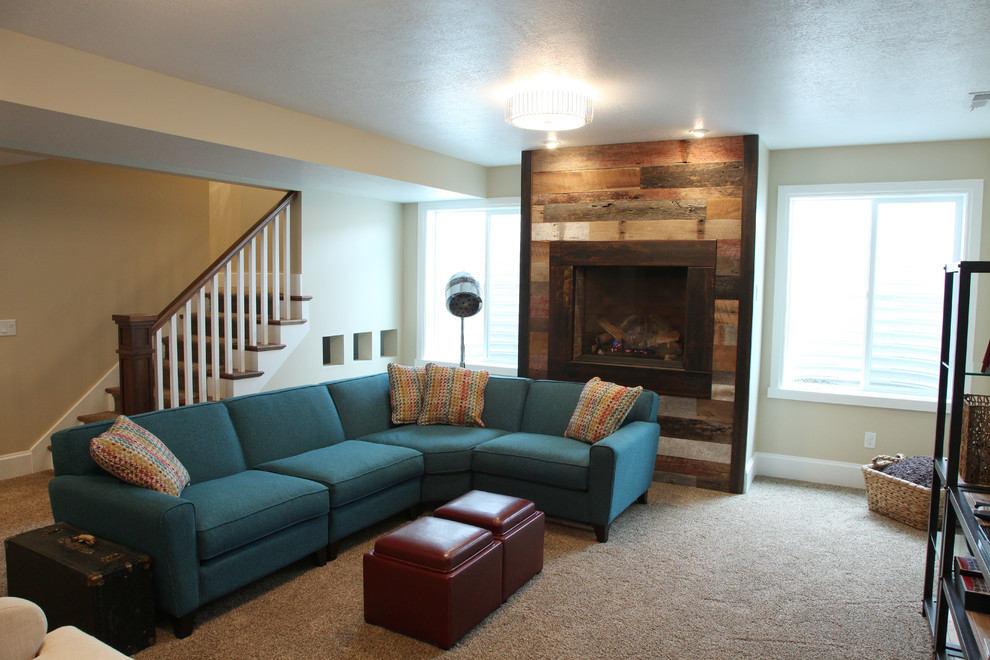 Basement - mid-sized traditional look-out carpeted basement idea in Salt Lake City with beige walls and a standard fireplace