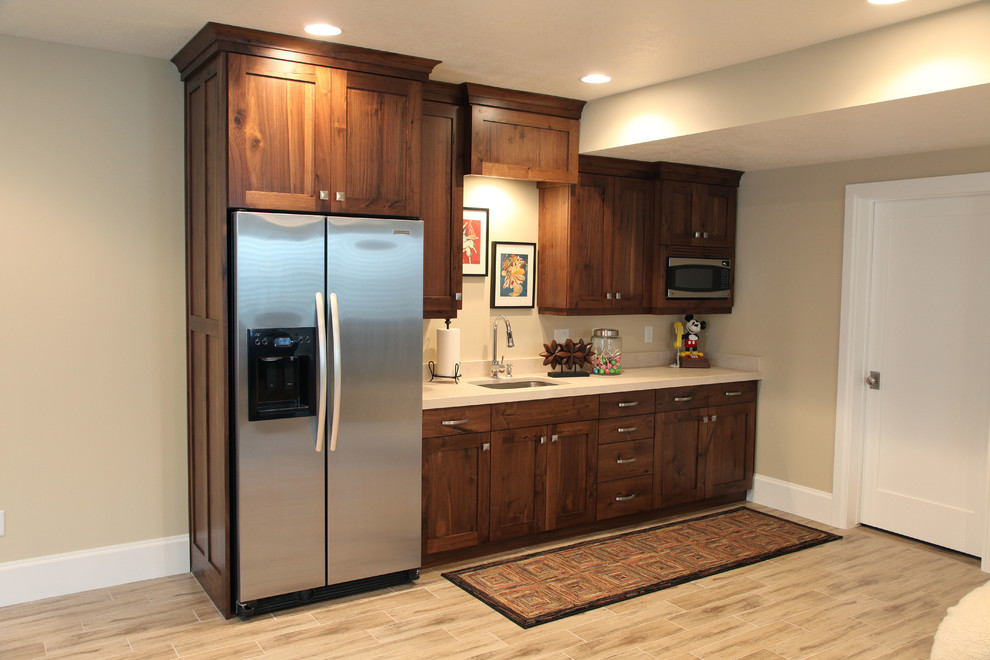 Inspiration for a mid-sized timeless look-out porcelain tile basement remodel in Salt Lake City with beige walls