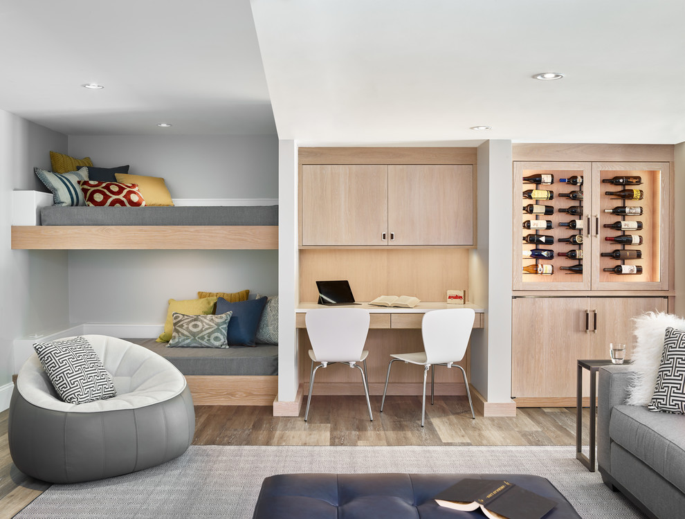 Example of a mid-sized trendy dark wood floor and brown floor basement design in Boston with gray walls
