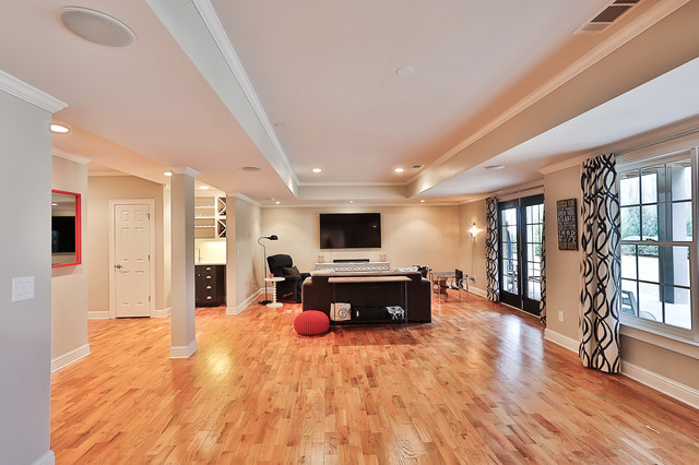 Inspiration for a mid-sized transitional walk-out light wood floor basement remodel in Atlanta with gray walls and no fireplace