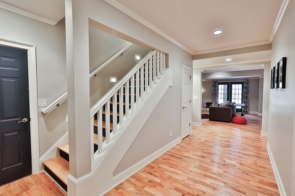 Inspiration for a mid-sized transitional walk-out light wood floor and beige floor basement remodel in Atlanta with gray walls and no fireplace