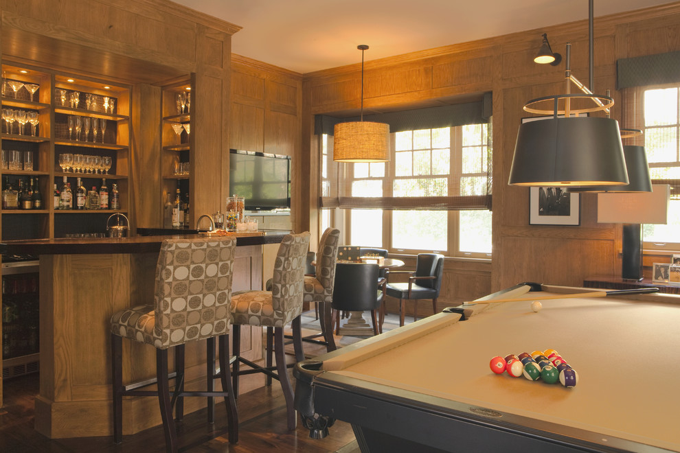 Example of a transitional look-out dark wood floor basement design in Los Angeles