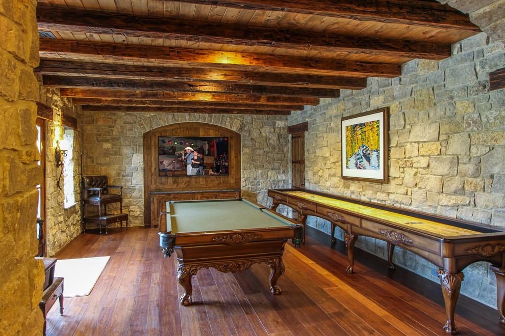 Example of a classic medium tone wood floor basement design in Cincinnati