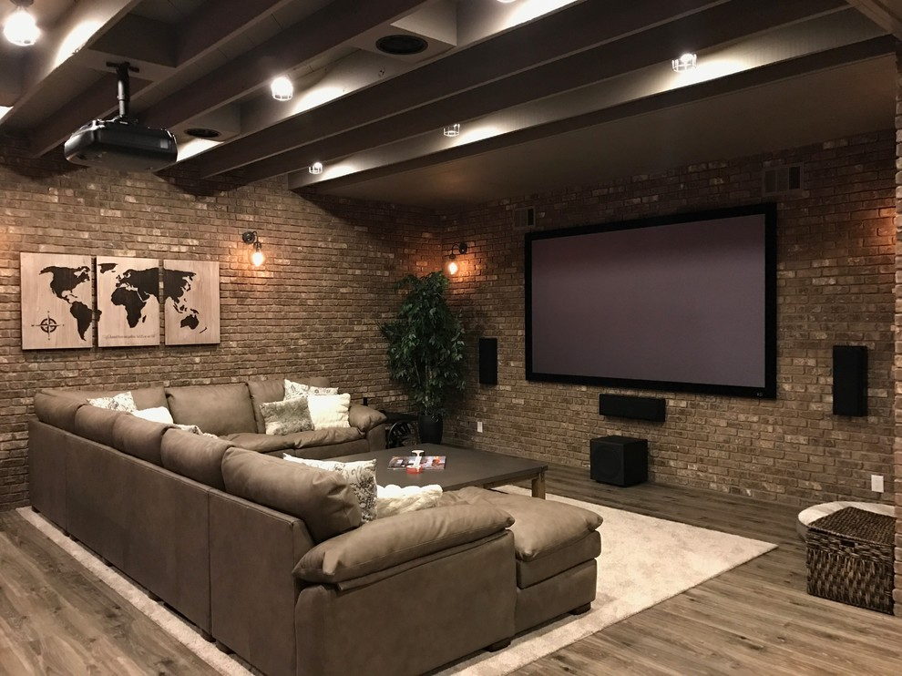 Urban walk-out laminate floor and brown floor basement photo in Atlanta with brown walls and no fireplace