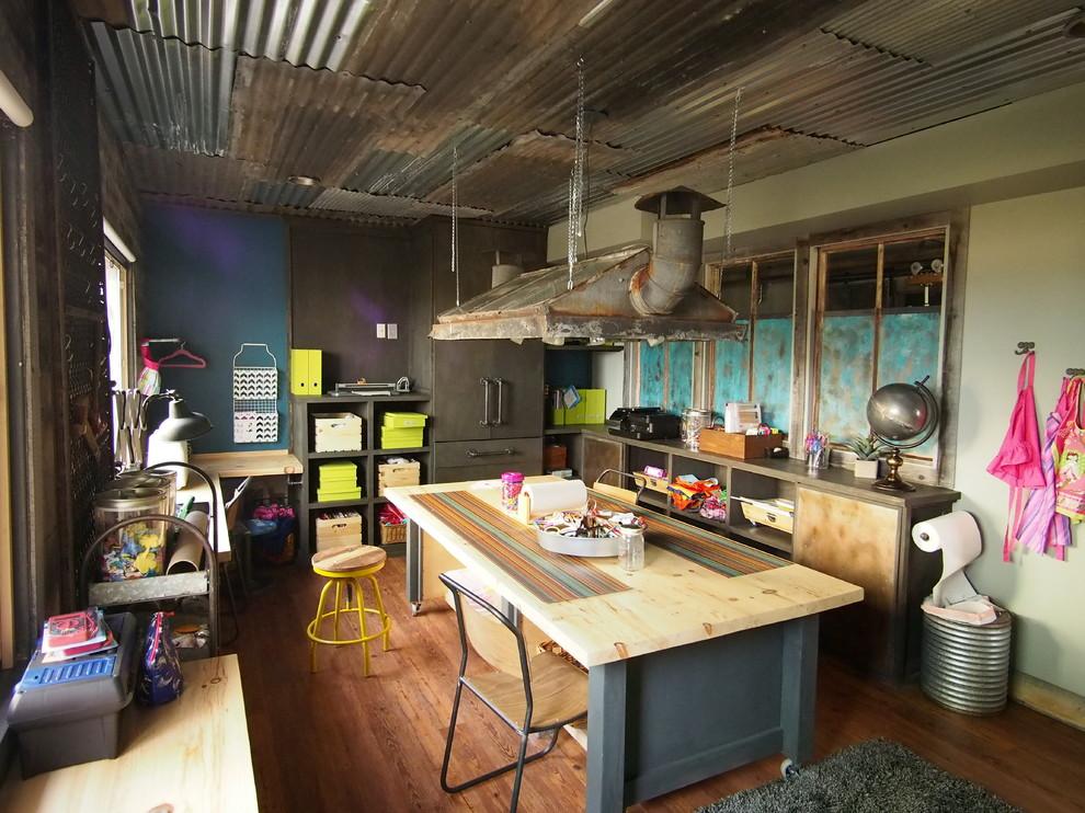 Large urban medium tone wood floor basement photo in Denver