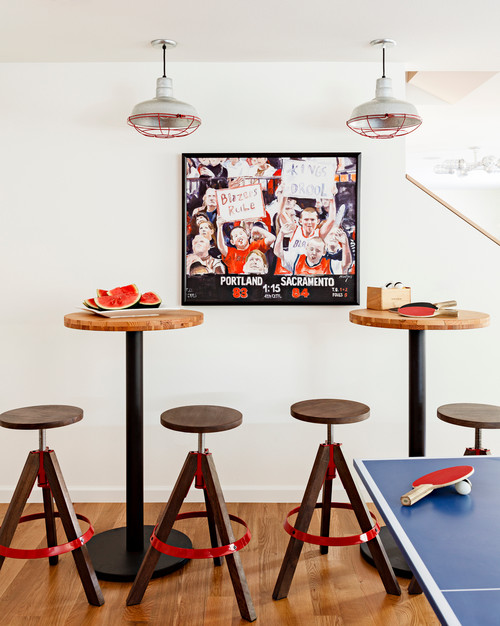 Two small pub tables with backless stools near a ping pong table, great for watching the game