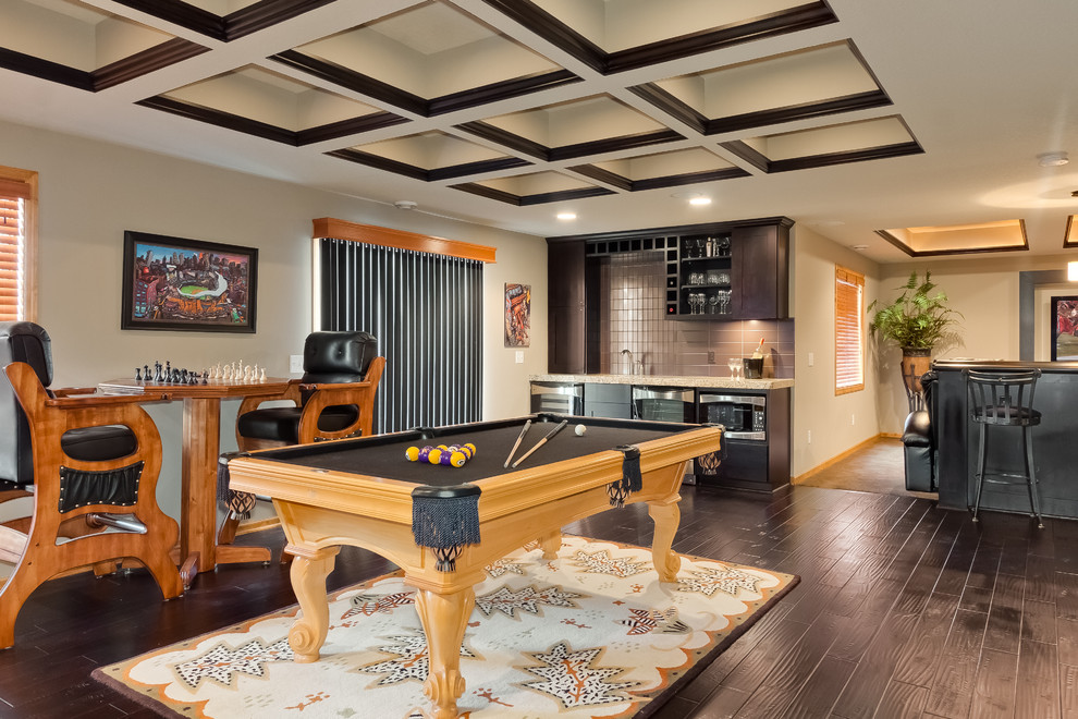 Large trendy underground gray floor and dark wood floor basement photo in Minneapolis with beige walls and no fireplace