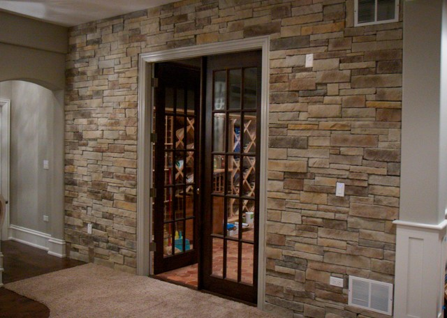 Interior stone veneer basements traditional basement for Interior rock walls designs
