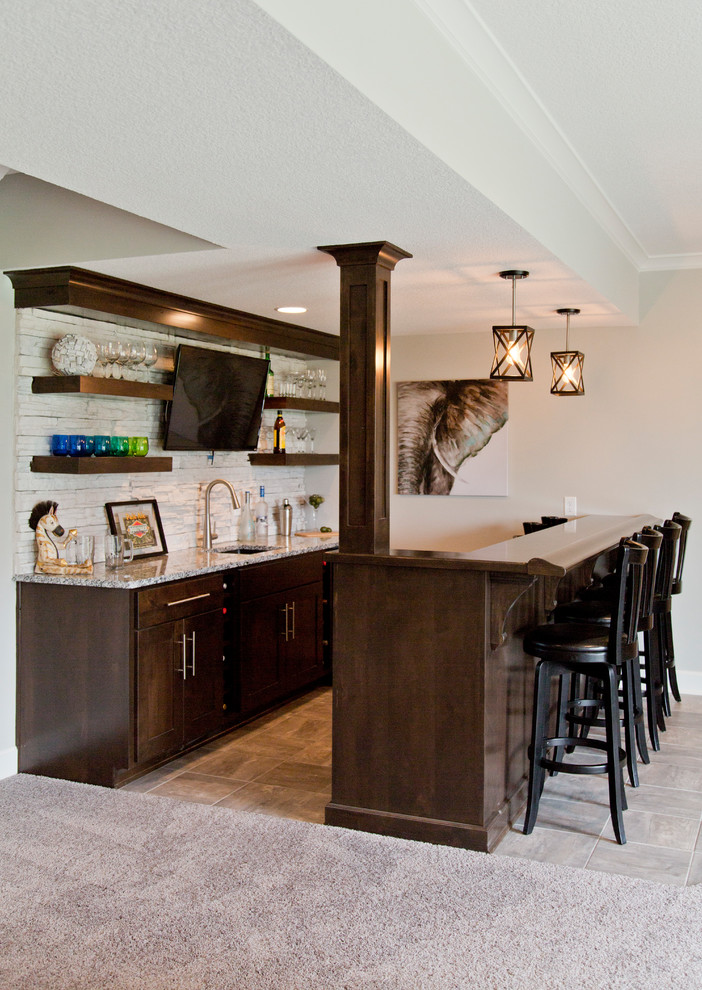 Example of a large cottage walk-out carpeted and gray floor basement design in Kansas City with beige walls