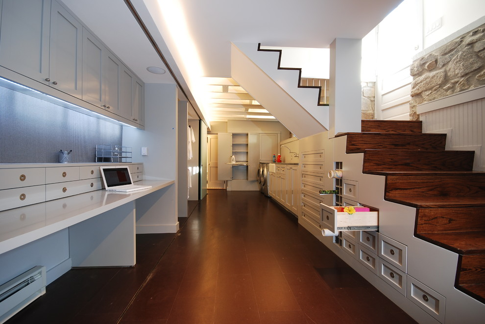 Inspiration for a transitional underground basement remodel in DC Metro with white walls and no fireplace