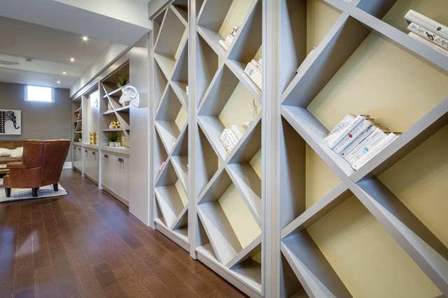 Inspiration for a large modern look-out medium tone wood floor basement remodel in Toronto with white walls