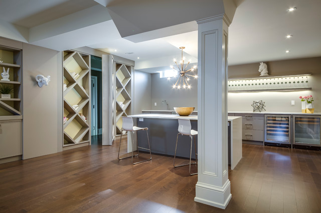 Large minimalist look-out medium tone wood floor basement photo in Toronto with white walls